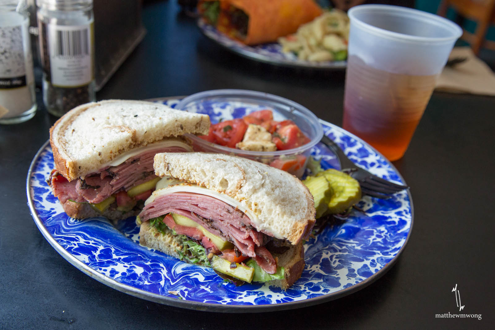 Cafe Sandwich, Mixed greens, tomatoes, and pesto mayo on focaccia with your choice of meat & cheese: roast beef & cheddar