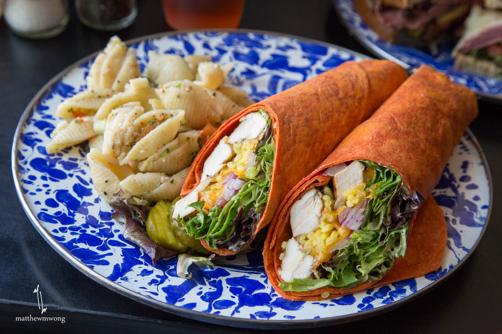 Spicy Chicken Wrap, Grilled chicken with melted cheddar, yellow rice, onions, tomatoes and mixed greens on a sundried tomato wrap with spicy ranch.