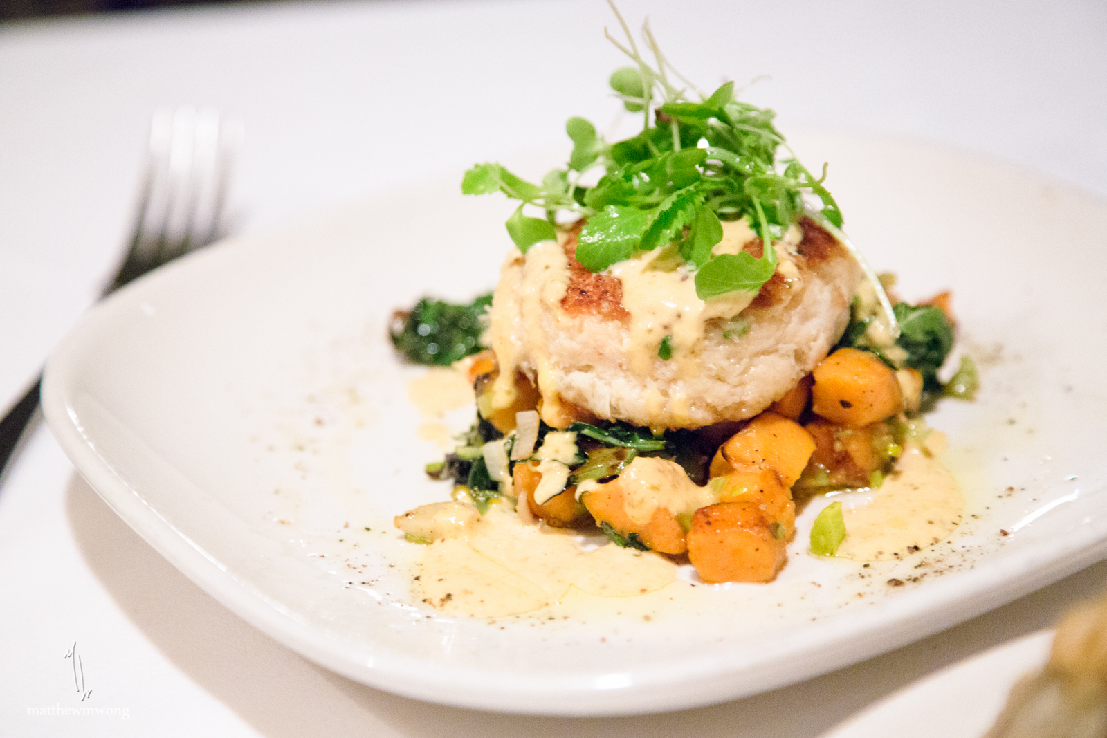 Crab cake on sweet potato hash