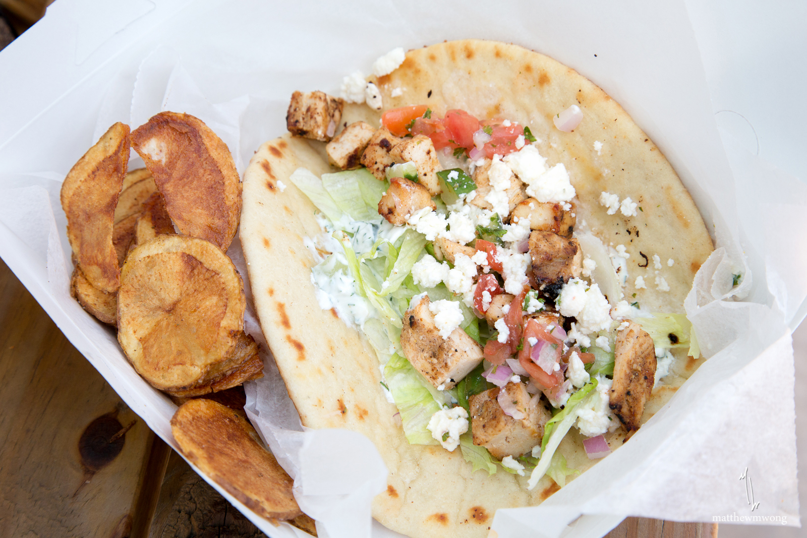 Chicken Shwarma, tzataziki, marinated grilled chicken breast, mediterranean salsa, lettuce, feta, on pita