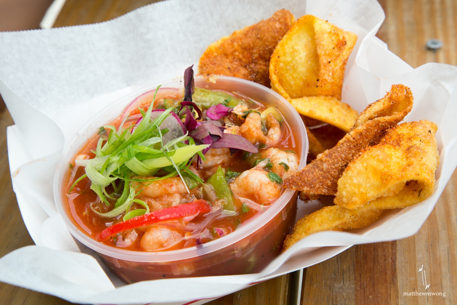 Cajun Rock Shrimp Ceviche, Rock Shrimp marinated in nectar of the gods, served cold with deep fried wonton chips