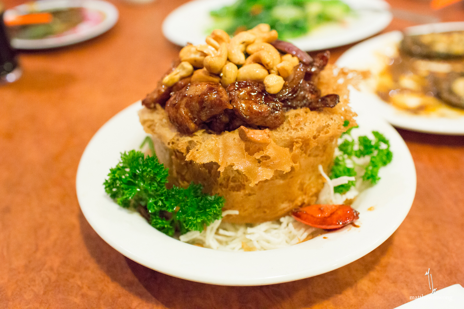 Chicken Yam Pot, Deep fried yam ring filled with stir fried chicken, vegetables, and cashew nuts
