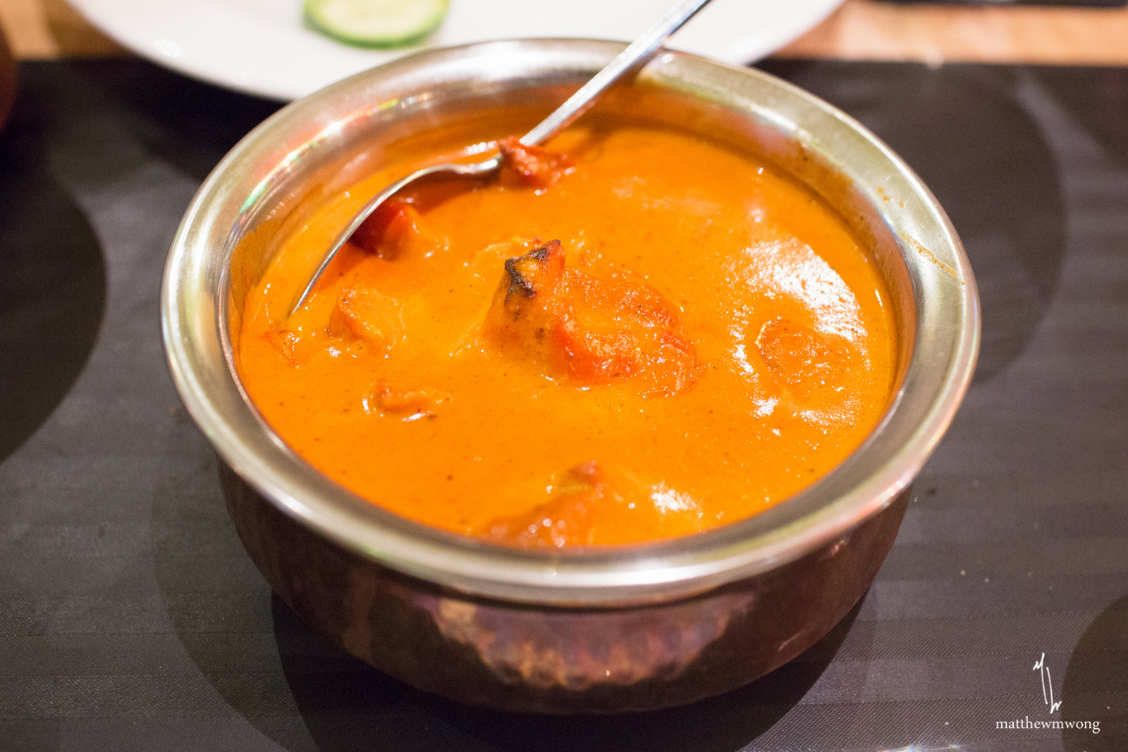 Butter Chicken, chicken cooked in tomato and creamy sauce