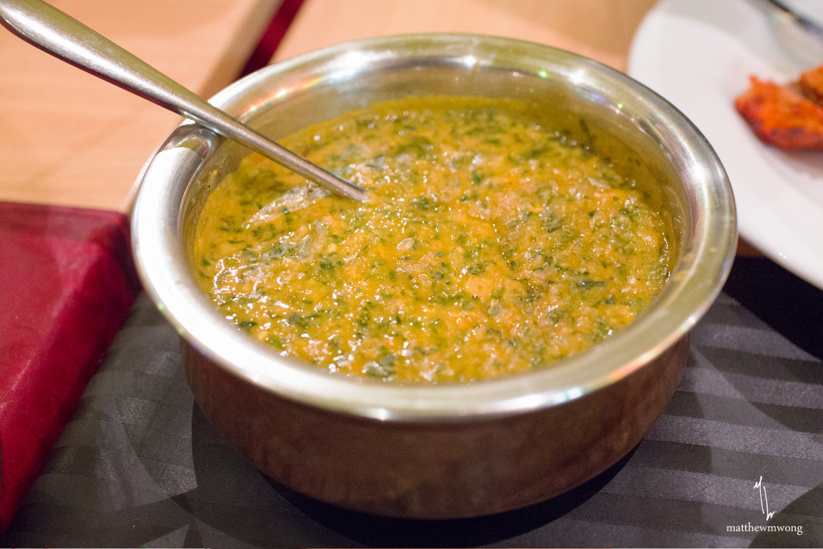 Alu Palak, quarters of potato and spinach in curry