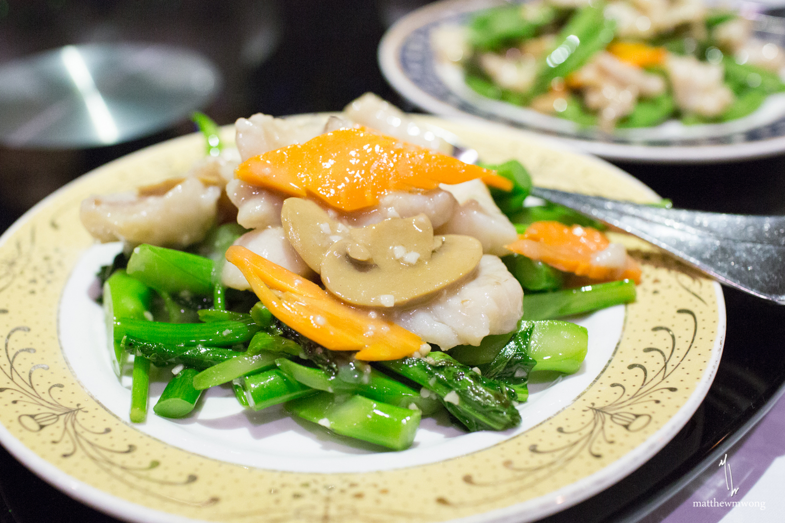 Slices of Rock Cod stir fried with mushrooms, carrots, and gailan