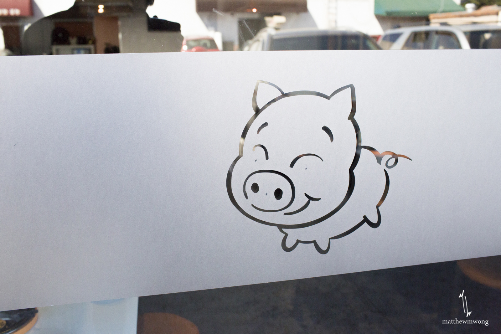 Outside store front. Funny pig.