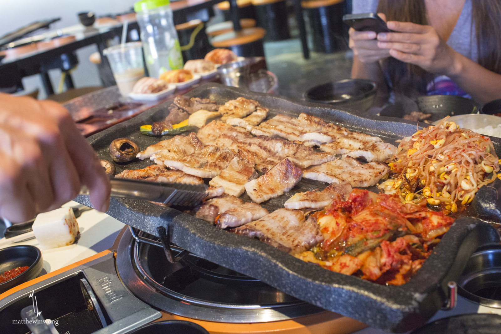 Full service Korean BBQ. Grills, cuts, replenishes your panchan, and fills up your drink quite regularly! Great service.