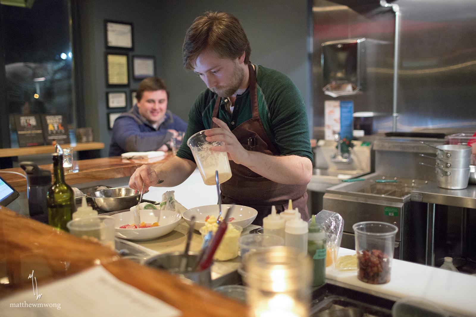 Chef Jonathan Miller finishing up the Yellowfin crudo.