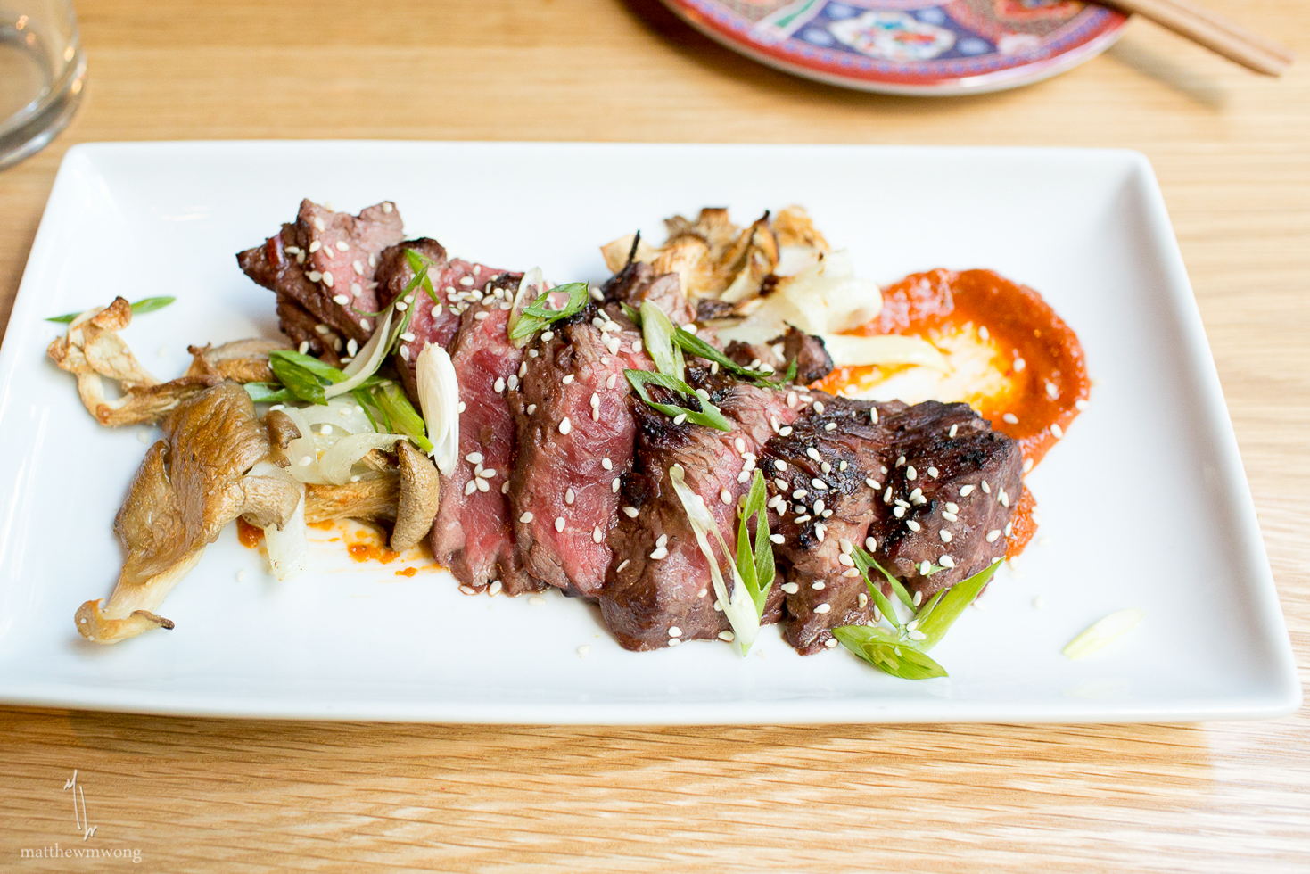 Kalbi Butchered Steak - roasted mushroom, charred onions, sesame seeds, Ssamjang sauce