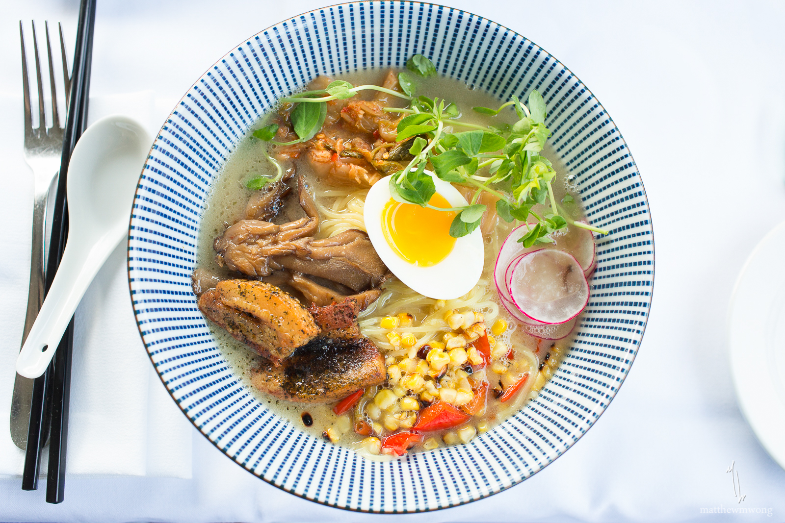 Tonkotsu Ramen- Pork belly, soft boiled egg, soy pickled mushrooms, roasted sweet peppers, grilled corn, shaved radish, kimchi