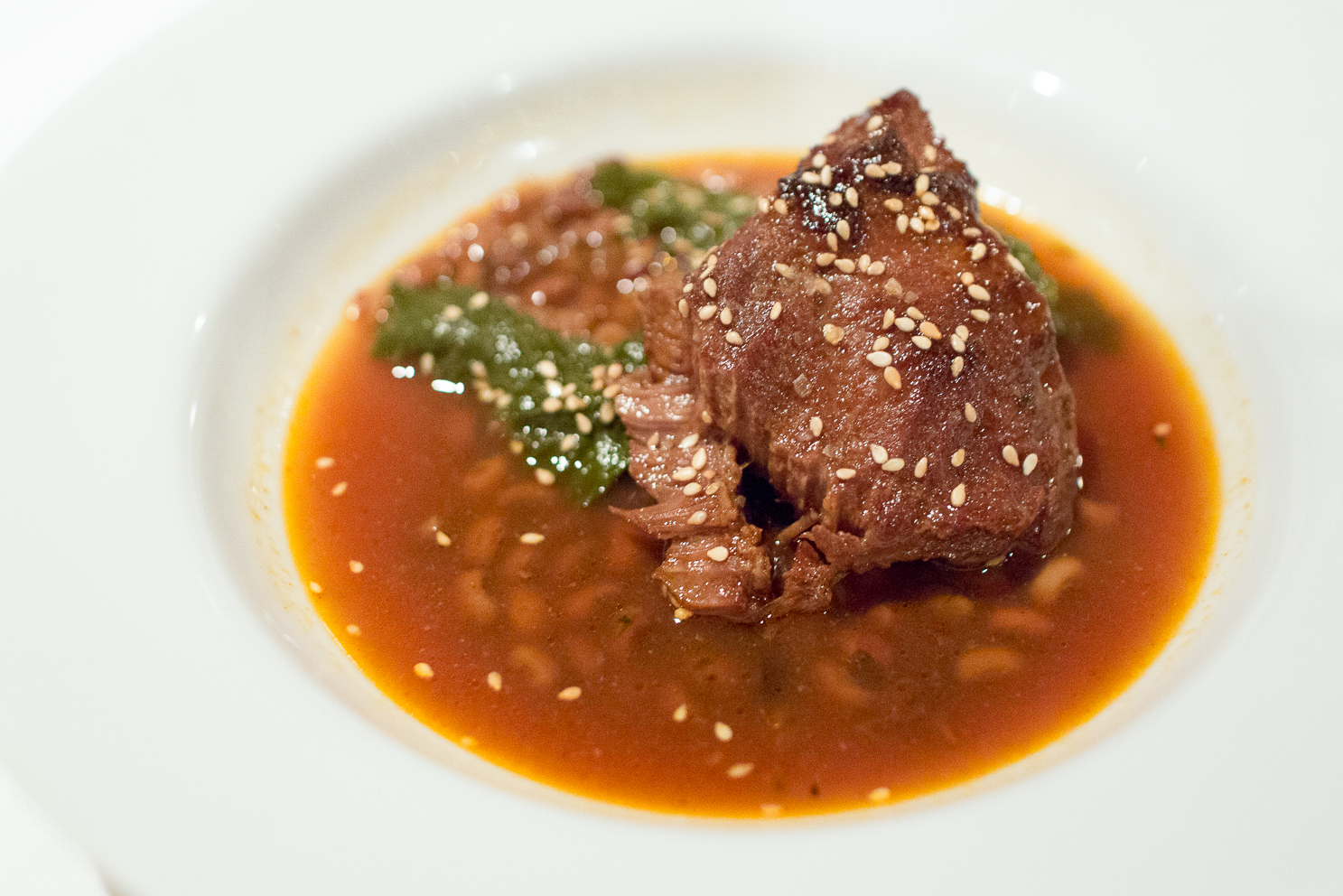 Braised Veal Cheeks, Sea Island Red Peas, Red Russian Mustard Greens, Lemon, Benne