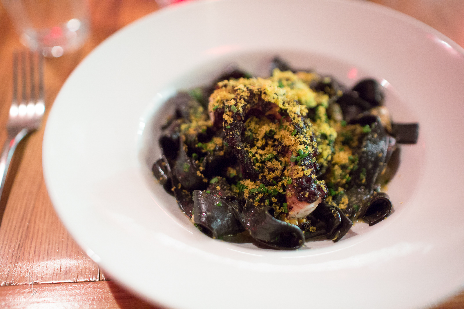 Squid Ink fettuccine, octopus, mussels, lemon, parsley, bottarga
